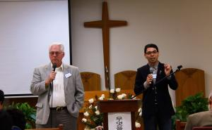 Dick Davis and Pablo Kim encourage people to come up and share words of encouragement
