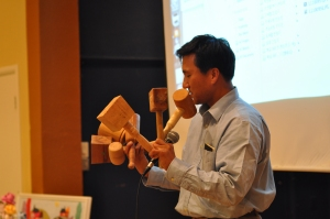 "Pastor Kim displays the many hammers he made during ""Handmade Life"" seminar."